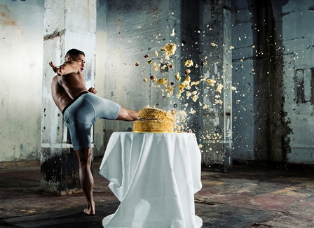 Image of MMA artist Tom 'Fire Kid' Duquesnoy kicking through the top tier of a wedding cake, showing the split-second moment of impact. Image taken by professional sports photographer Tom Miles using the Nikon D500, which shoots at 10 frames per second.