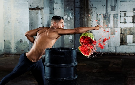 Image of MMA artist Tom 'Fire Kid' Duquesnoy punching through a watermelon, showing the split-second moment of impact. Image taken by professional sports photographer Tom Miles using the Nikon D500, which shoots at 10 frames per second.